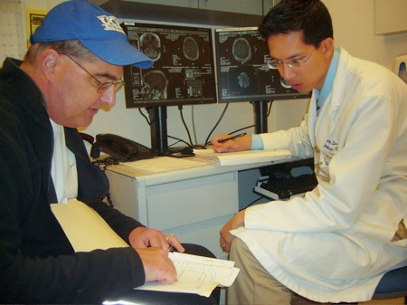 Chris shows his charts to Dr. Lu during Neuro-Oncology consult