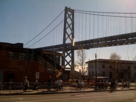 Olympic protesters walk up Embarcadero by the Bay Bridge