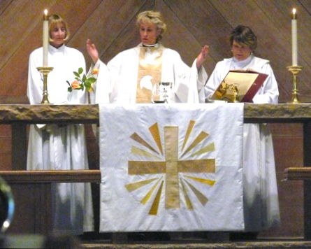 Linda, Frannie Hall-Kieschnick and Beth Foote celebrate the Eucharist at Trinity