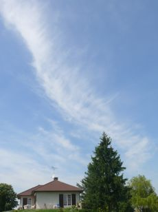 Sky and cloud over house at Lhomont crossroads