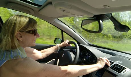 Linda at the wheel of our rented Peugeot 407