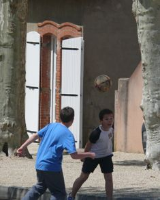 Boys playing with soccer ball in Romenay