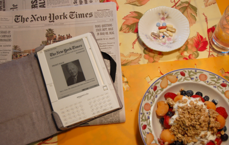 My Kindle on the breakfast table, with print predecessors