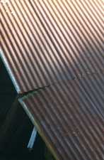 Light and shadow on a corrogated metal roof
